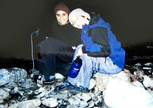 Two UCSF students sitting on river rocks in the evening about 2004